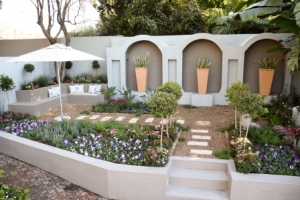 Entering the garden your eye is instantly attracted to the architecture with the tall arches